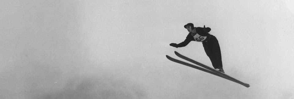 Jack Reddish jumping on Ecker Hill, early 1940s.